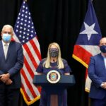 Officials in Puerto Rico try to balance public health precautions with economic stability